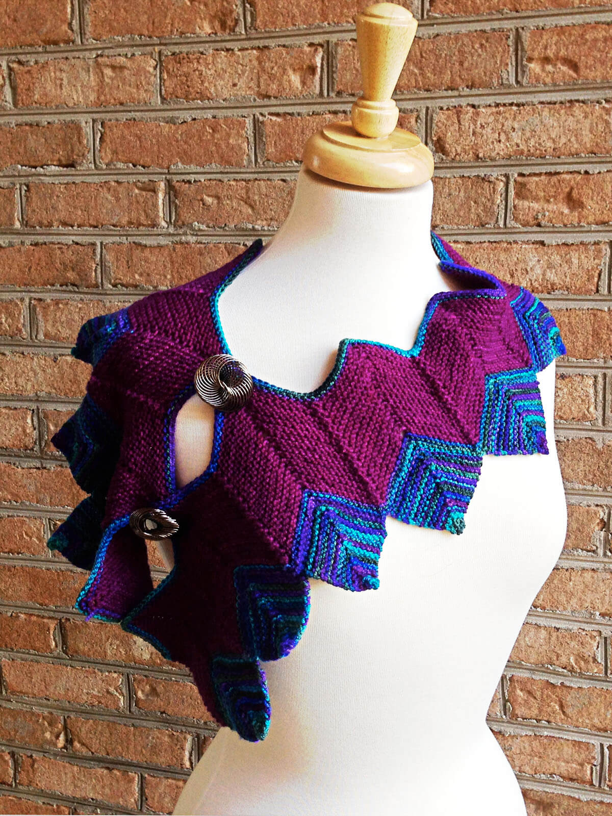 purple and blue mitered-square and chevron scarf on dress form