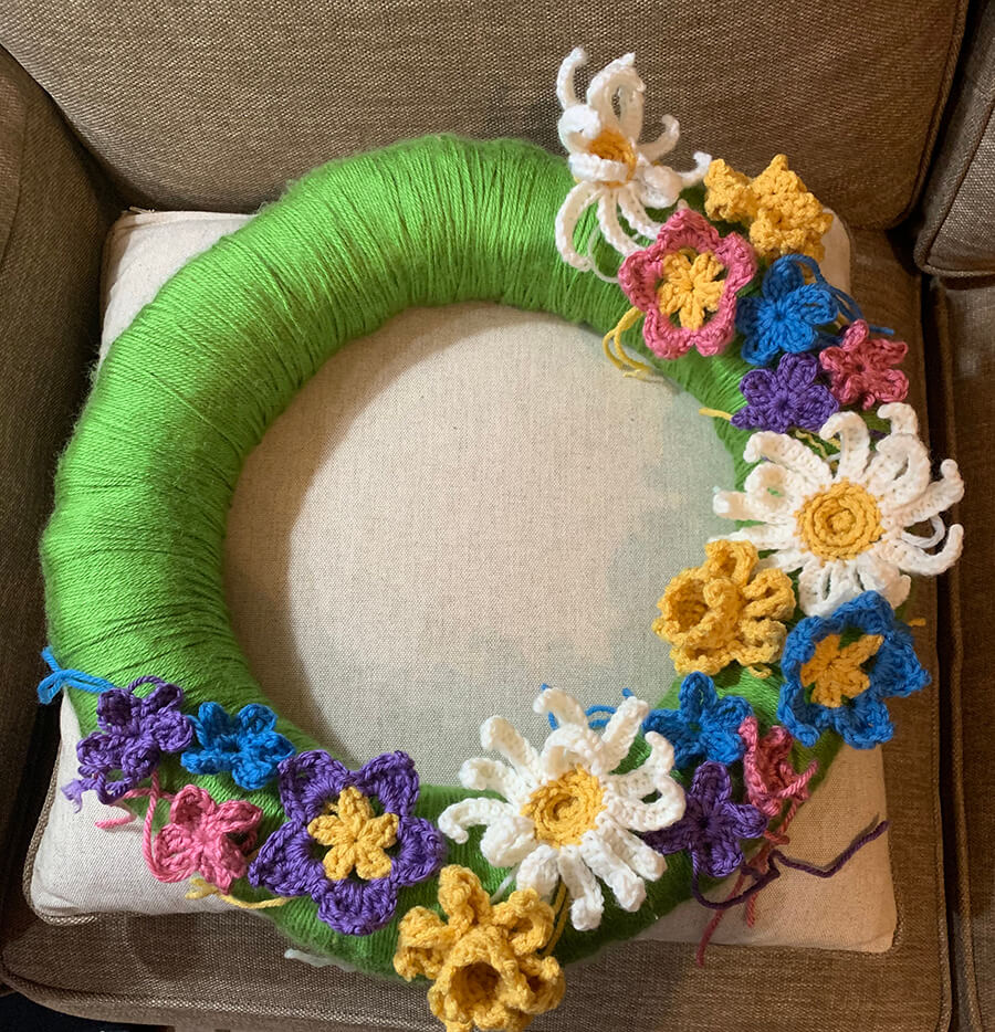Wreath with crocheted flowers