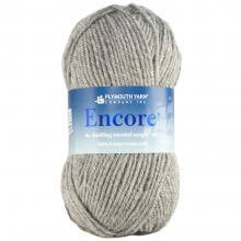 Grey ball of Encore yarn Skill-Builder Crochet blanket