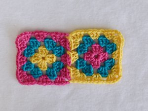 Two granny squares joined with flat join using join-as-you-go