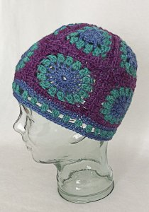 Granny square style hat in purple, teal and blue