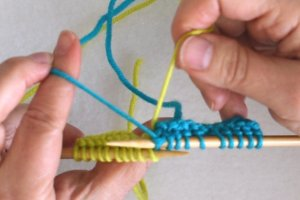 Garter Stitch Intarsia Pick up new color from underneath old color.