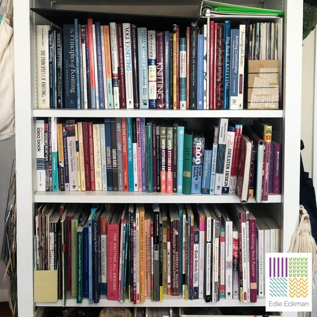 Bookshelf filled with reference books for fiber arts