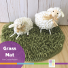 """two toy sheep on a crocheted """"grass"""" circle"""