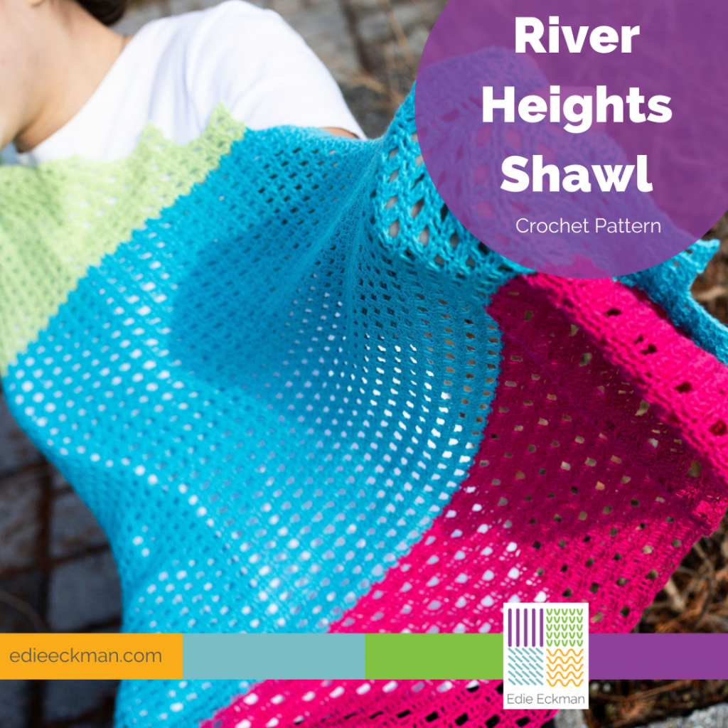 bright pink, turquoise, green shawl held by a woman - River Heights Shawl