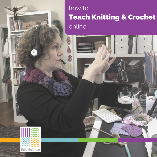 Edie standing in front of computer, teaching-How to Teach Knitting and Crochet Online