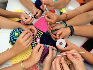 Young hands crocheting
