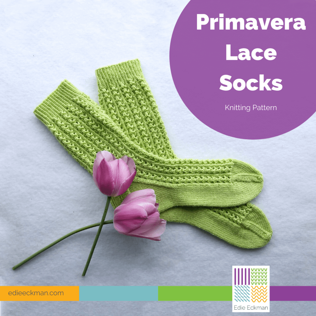 pair of lacy green knit socks with pink tulips