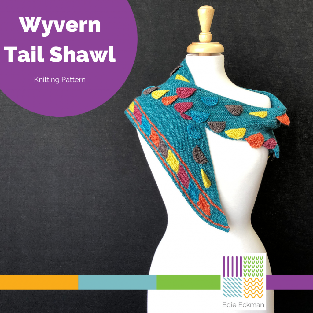 white dress form with a teal boomerang shawl embellished with colorful tabs