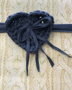 Cable-knit gift with crocheted heart