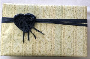 box wrapped with cable-knit paper