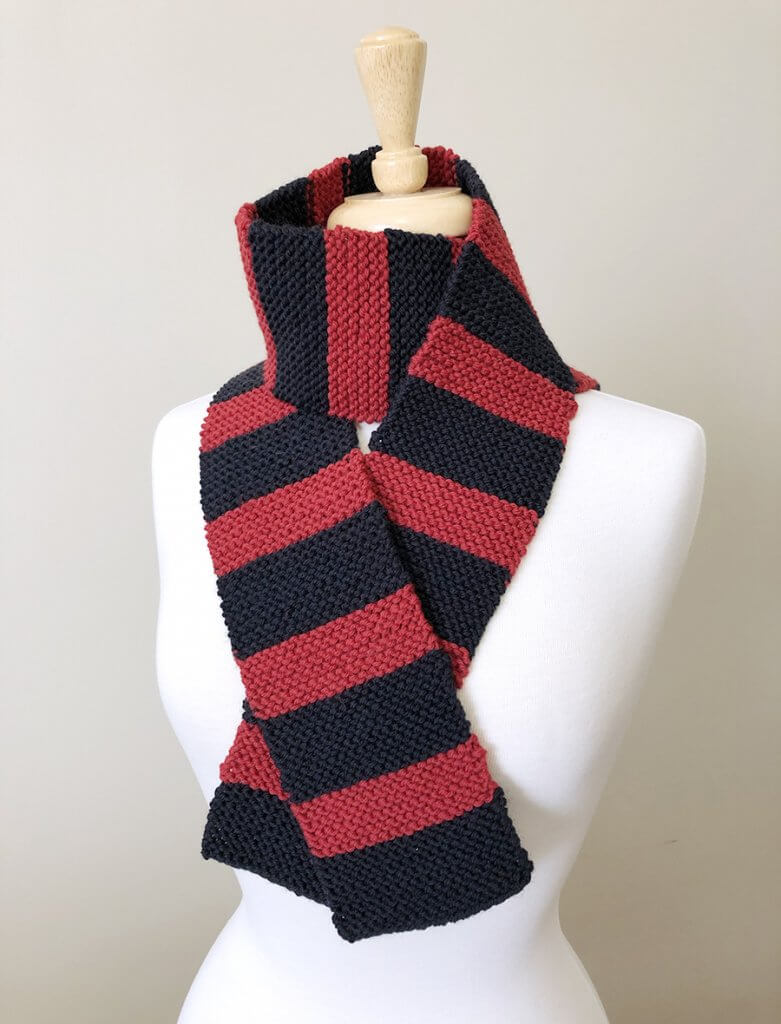 black and red garter stitch scarf on dress form