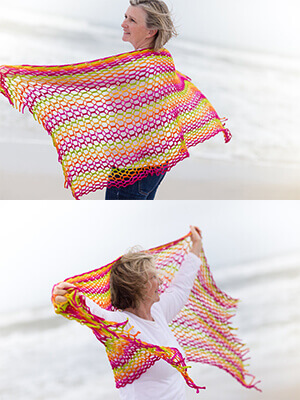 Dinkin's Bay Shawl Crochet Pattern- yellow/pink mesh shawl held out by woman at beach