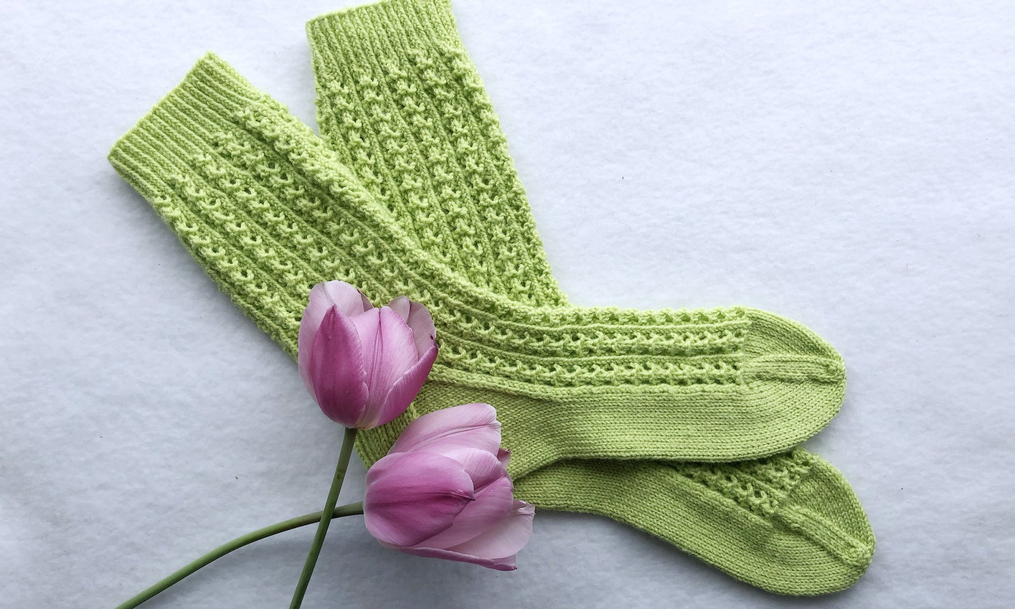 Primavera Lace Socks Knitting Pattern designed by Edie Eckman