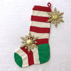 Red and white striped Christmas stocking with green heel and toe