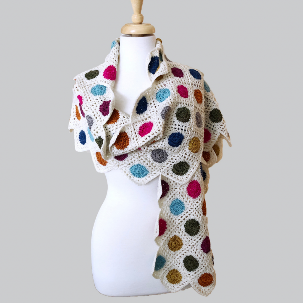 Shawl made from colorful circles with a white background