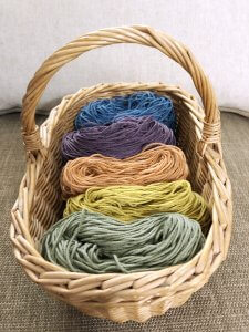 Basket of 5 colors of yarn ready to knit