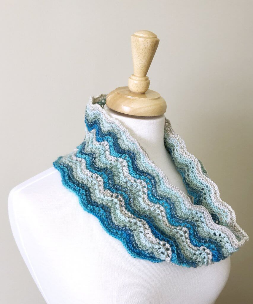 Teal/Aqua feather and fan patterned cowl on dress form