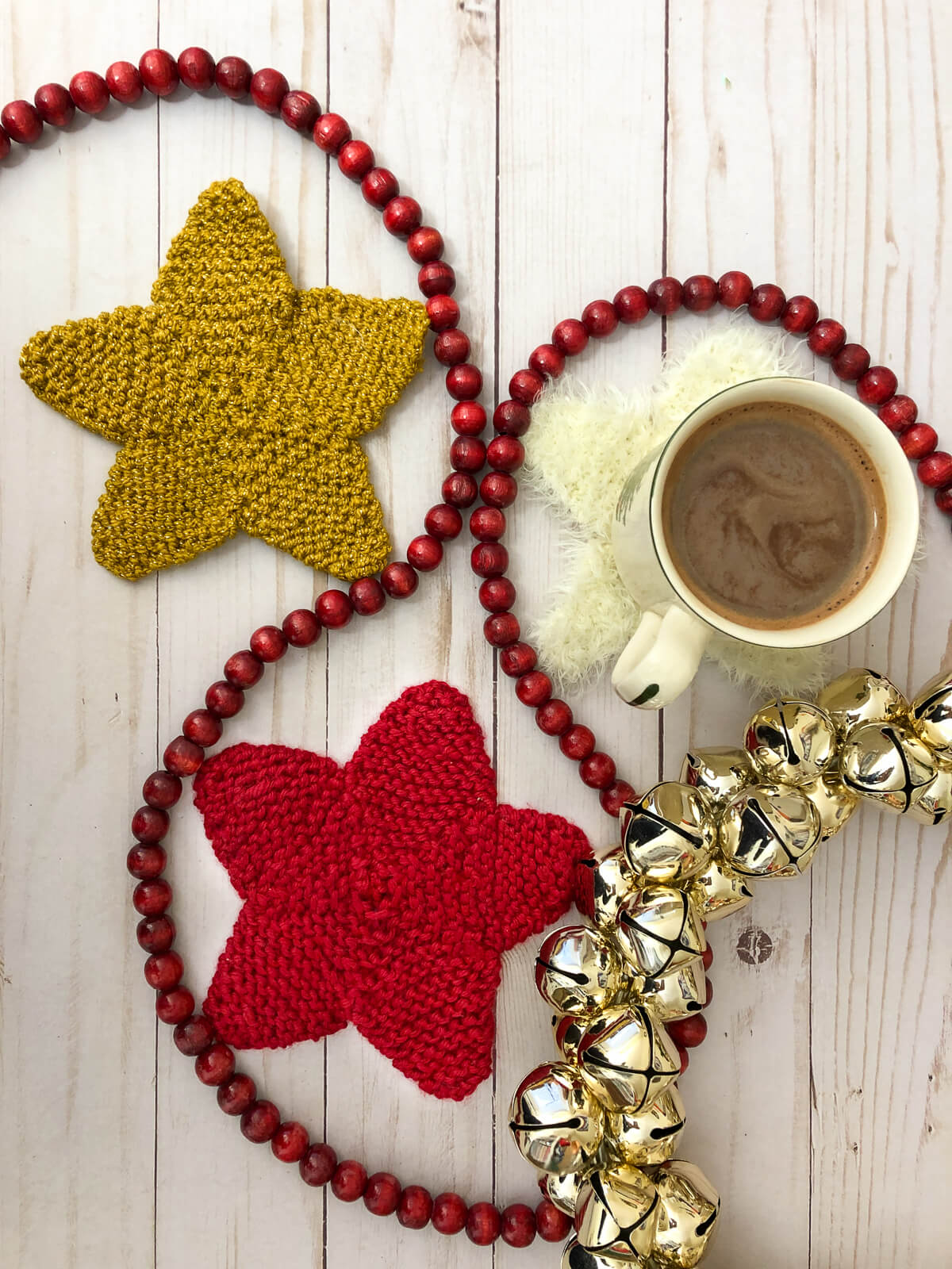 Gold red and white star coasters with hot chocolate