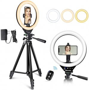 Ring light on adjustable tripod stand, with cell phone holder in center of the ring