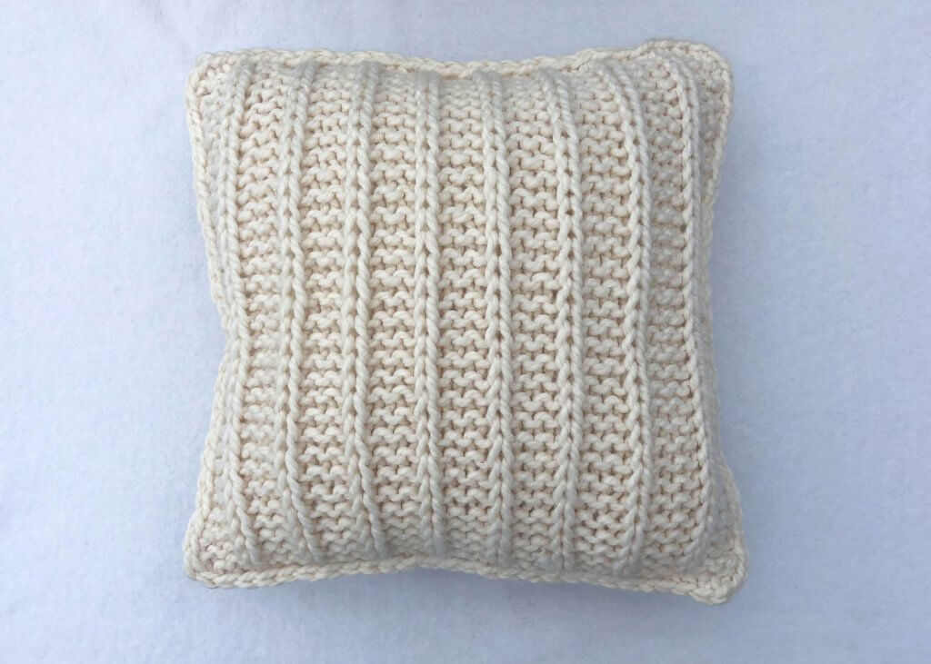 Slip Stitch Pillow flat lay
