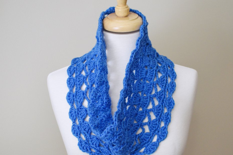Medium blue cowl with scalloped edges on dress form
