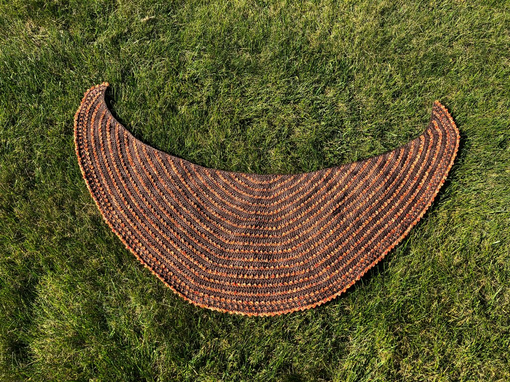 Eastvale Shawl-crescent shaped shawl flat lay on grass