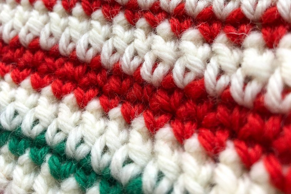 Closeup of red, white and green striped crocheted fabric