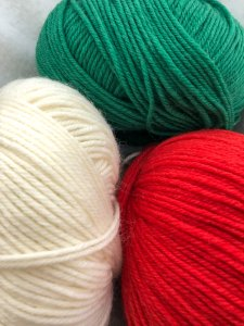 White, Green and Red yarn Universal Deluxe Worsted