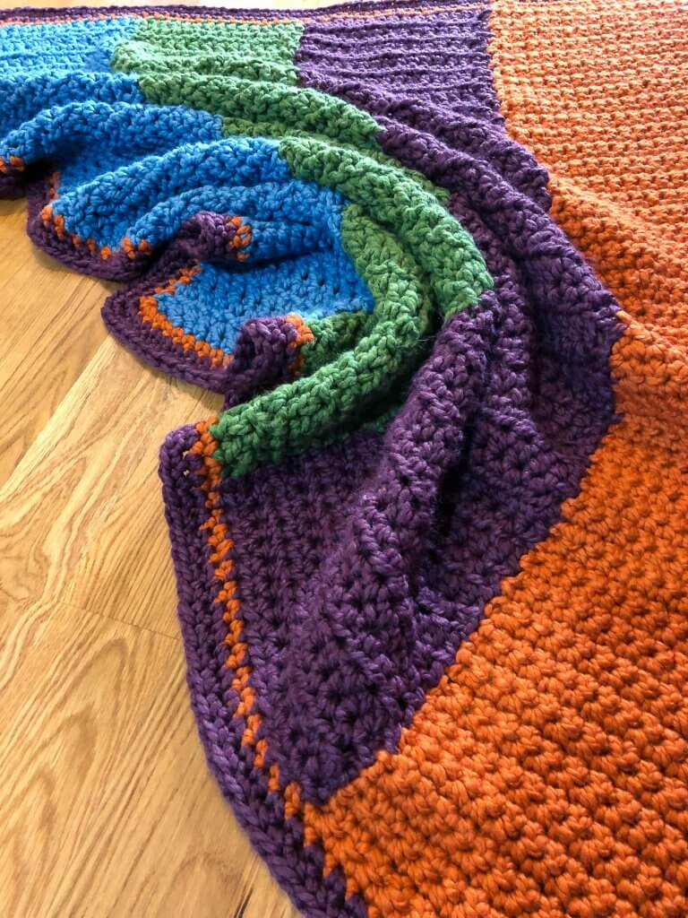 Four-color afghan with corner scrunched
