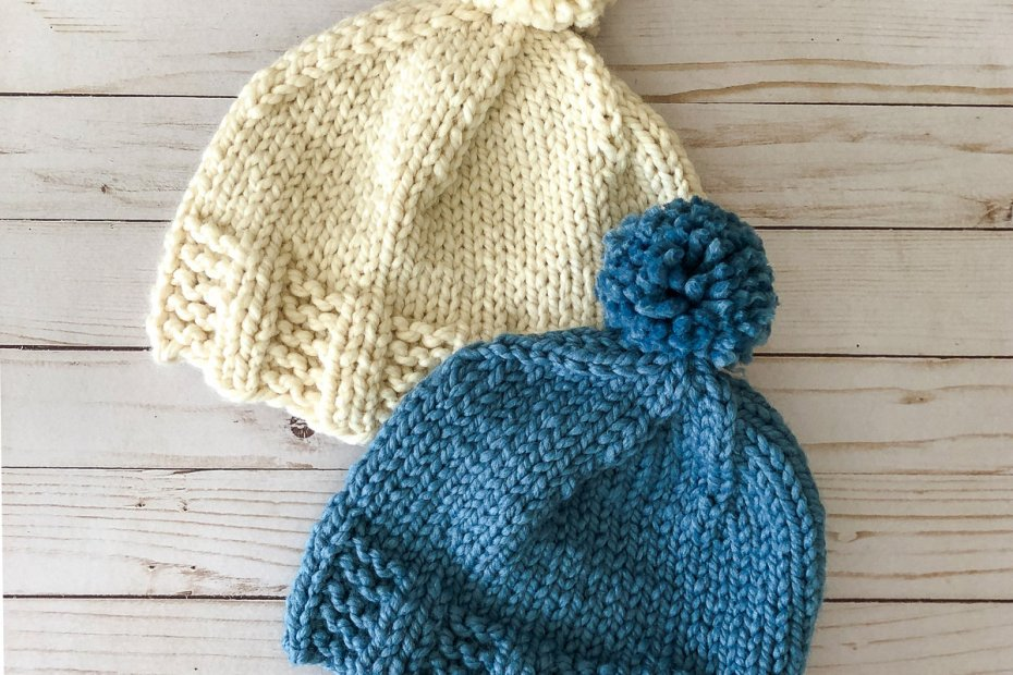 off-white hat and blue hat with pompoms