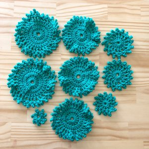 9 crocheted circles of varying sizes