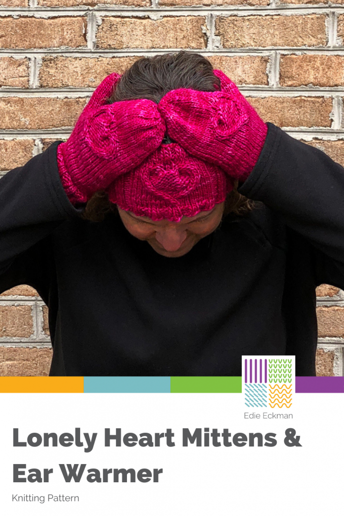 Photo of woman with mittened hands on head, wearing a heart headband/ear warmer