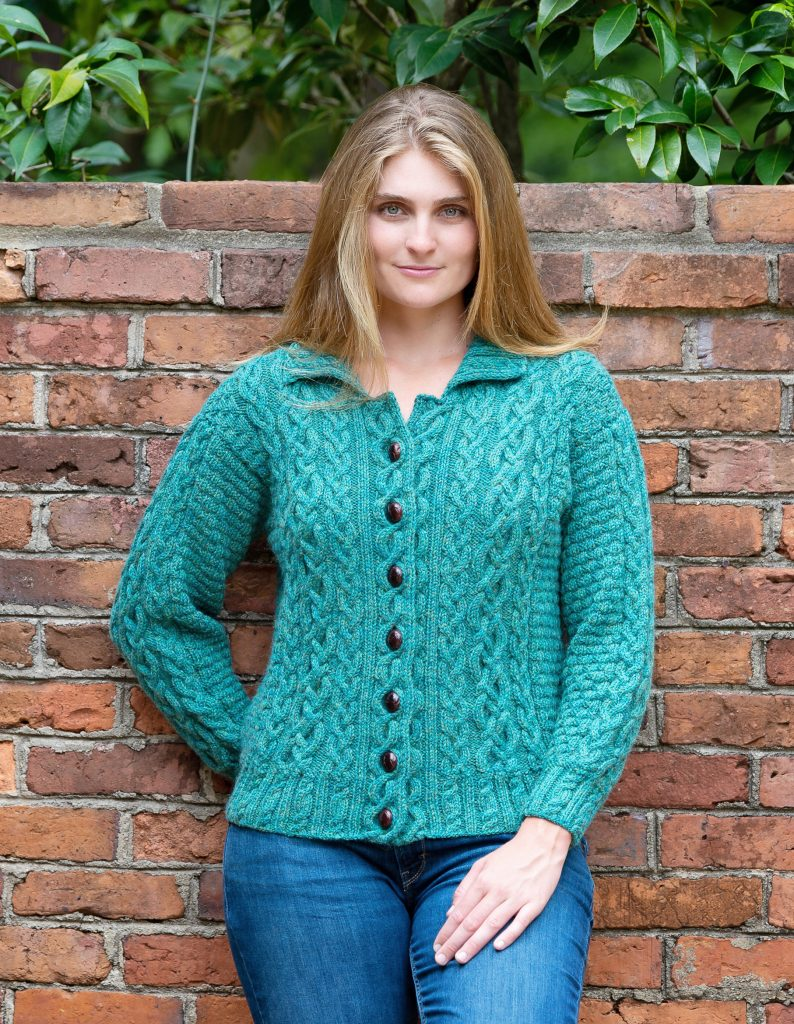 woman wearing green cabled cardigan