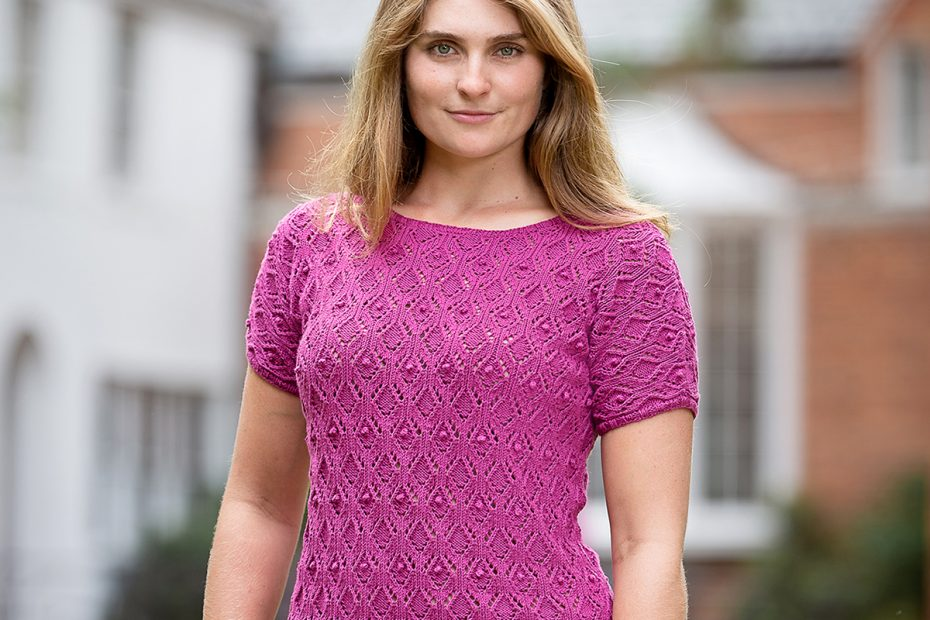 woman wearing pink lacy short-sleeved pullover
