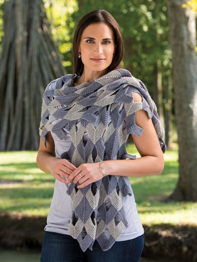 Woman wearing silver and blue mitered shawl