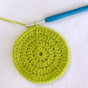 lime green double crochet circle with crochet hook