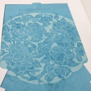 dyed blue fabric with floral design