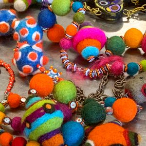 colorful felted balls and beads