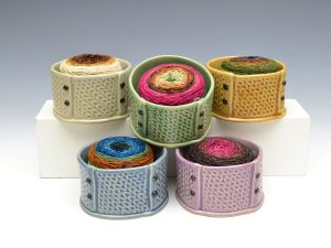 """5 """"knitting fabric"""" yarn bowls with gradient caked yarn inside"""