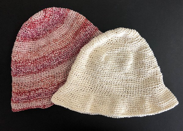 two hats flat lay on back background