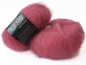 two balls of raspberry colored yarn with a slight fuzz to it