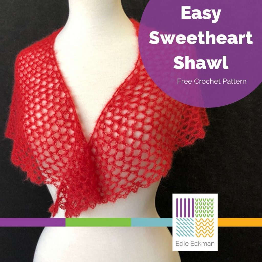 lacy red crocheted shawl on dress form