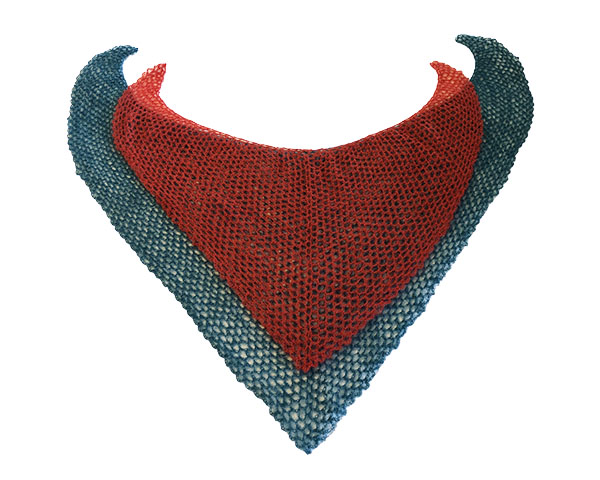 lacy red heart-shaped shawl on top of lacy green heart-shaped shawl, flat lay