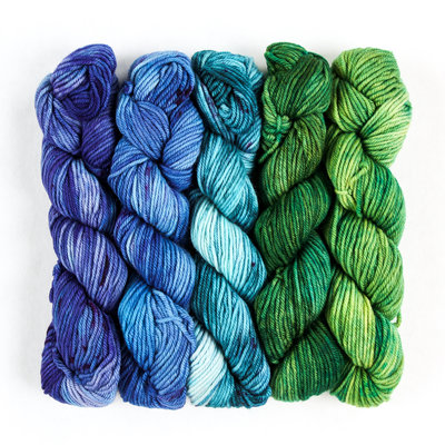 5 skeins of analagous color yarn ranging in color from green to blue