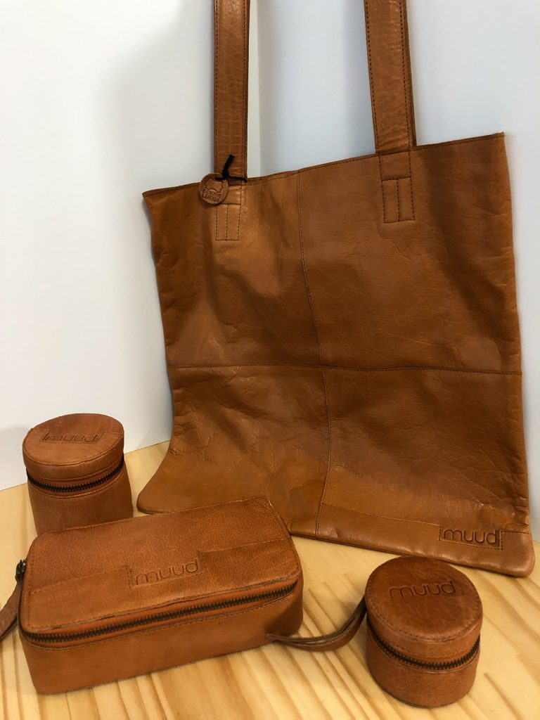 light brown leather products-tote bag, three zippered boxes in different sizes