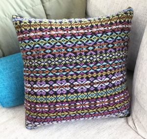 grey and muted colors patterned pillow