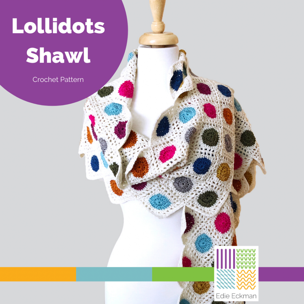 white crocheted shawl with colorful polkadot on dress form