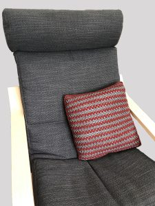 Ikea Poang chair with grey and wine striped pillow