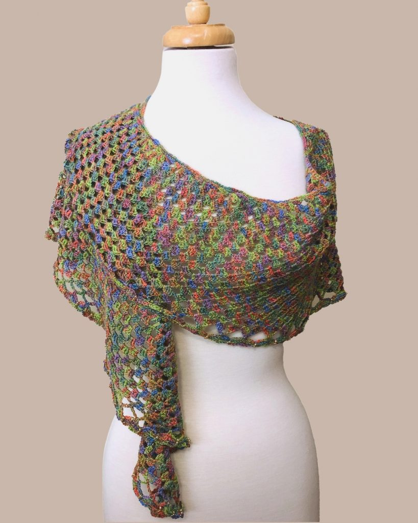 jewel-toned pastel lacy crocheted shawl on dress form